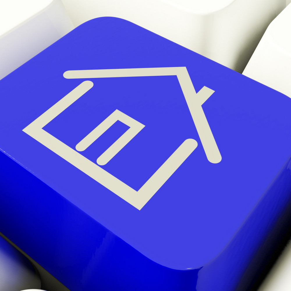 House Symbol Computer Key In Blue Showing Real Estate Or Rentals