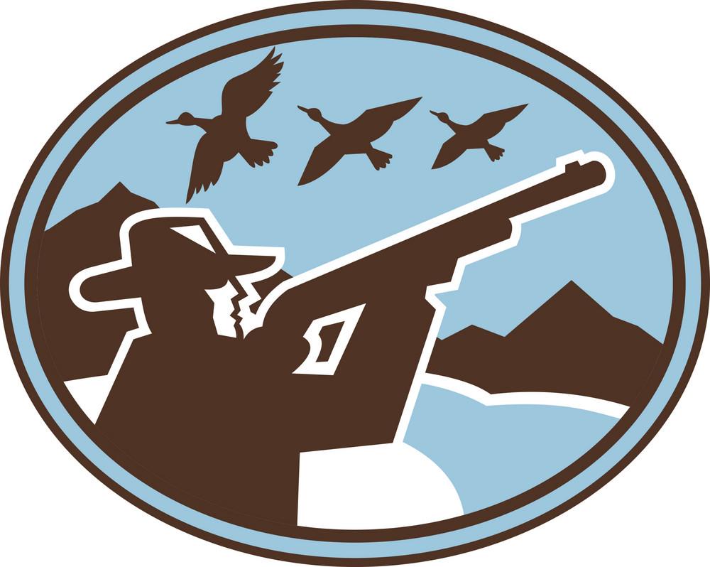 Hunter With Rifle Shooting At Ducks