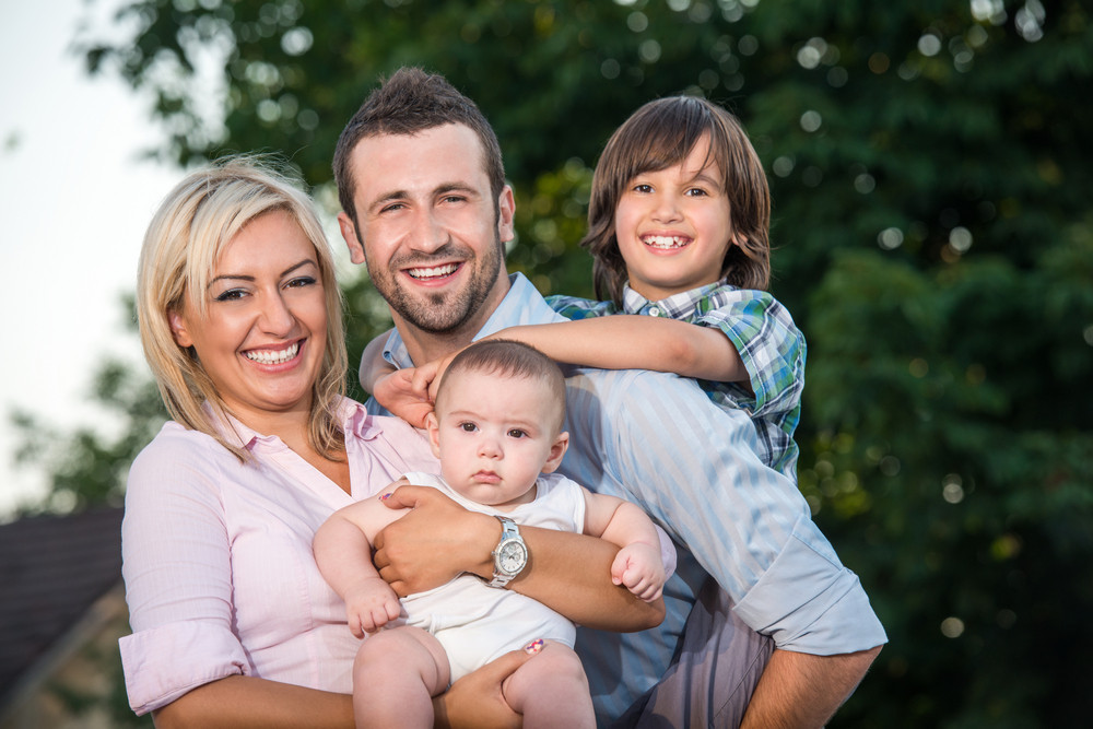 Idyllic happy family scene outdoors