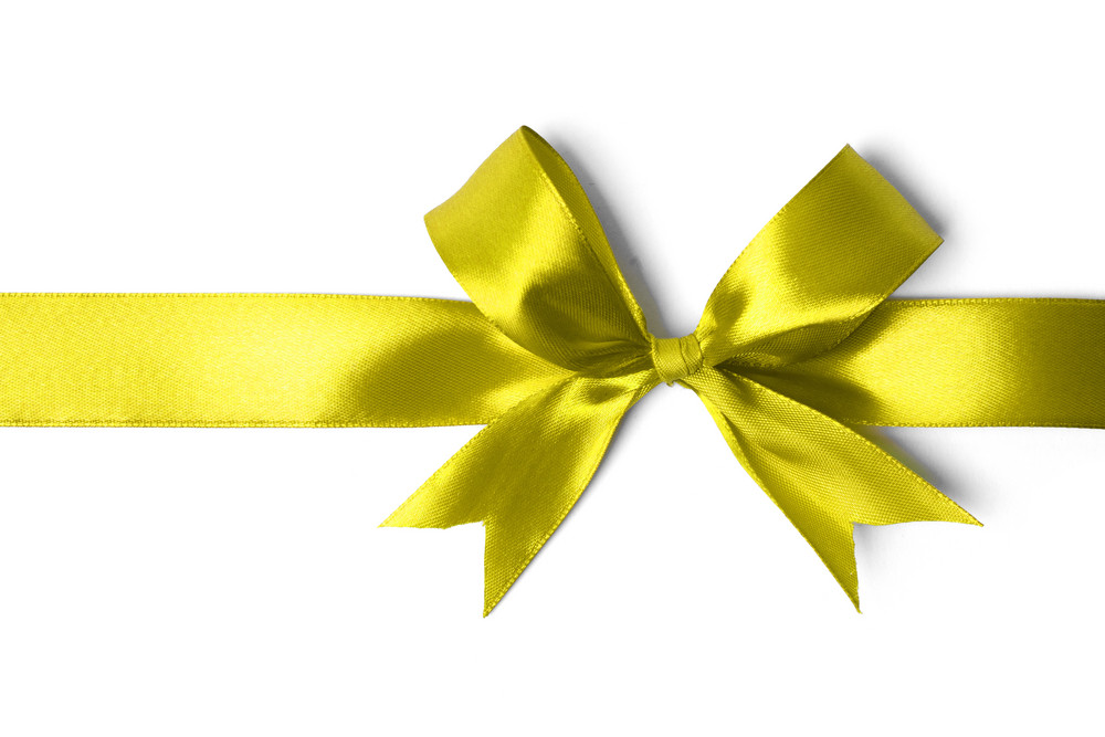 Yellow ribbon isolated on white background