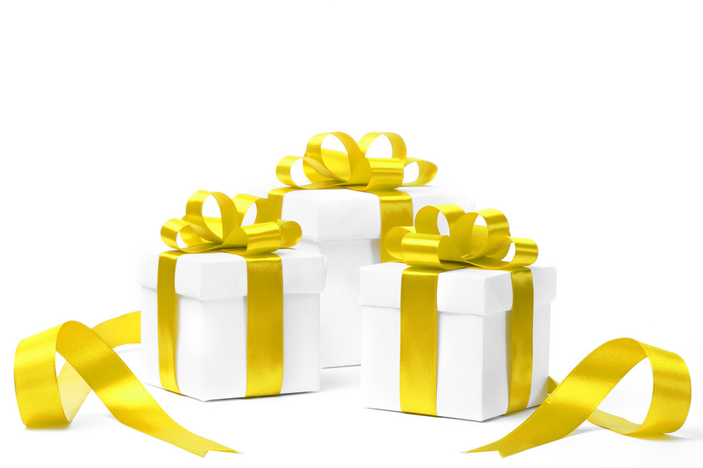 White gift box with yellow ribbon bow