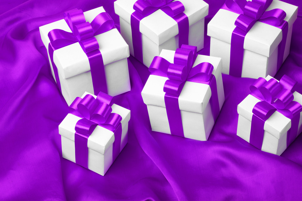 Gift on purple satin background