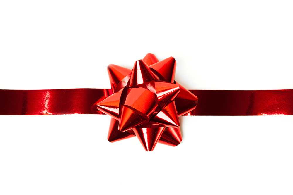 Gift red ribbon and bow isolated on white.