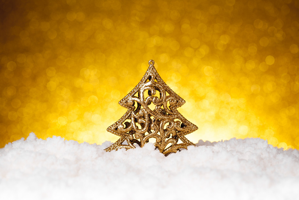 Golden christmas fir tree decoration with gold and red ornaments