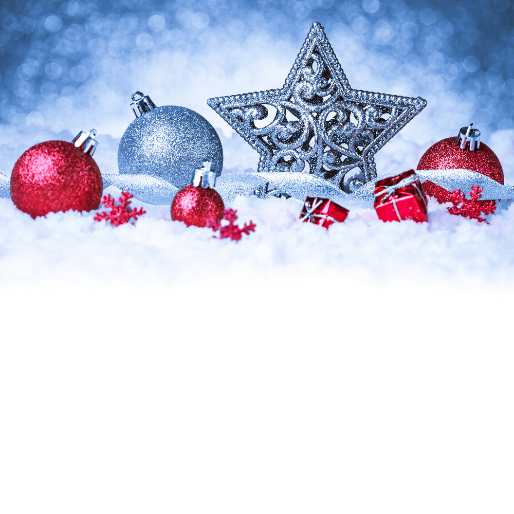 Christmas ornament in snow on glitter background