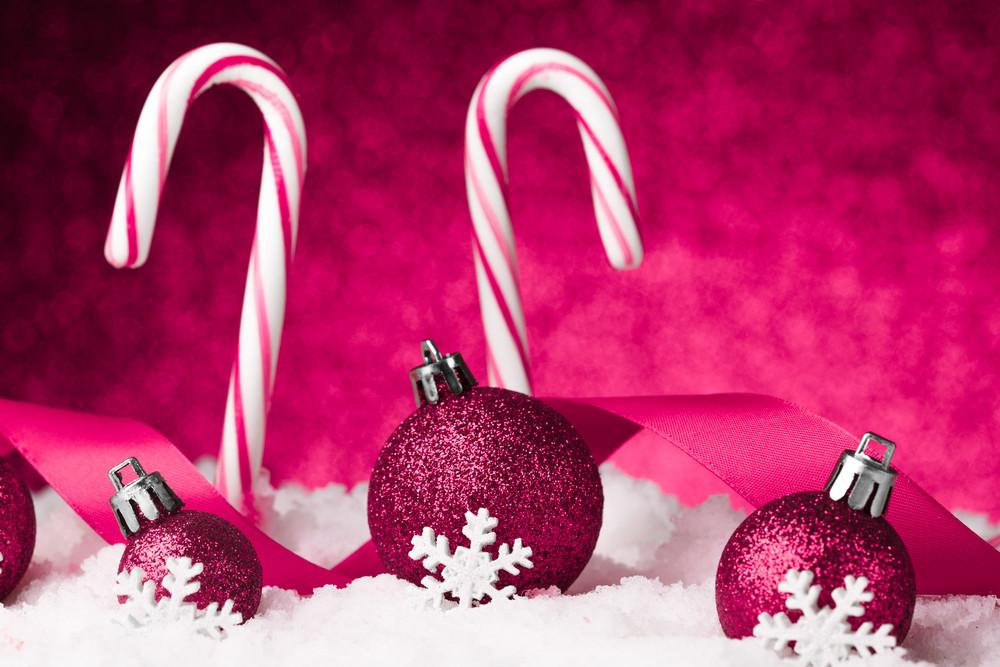 Purple christmas balls on snow