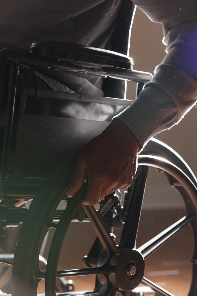 In wheelchair at home