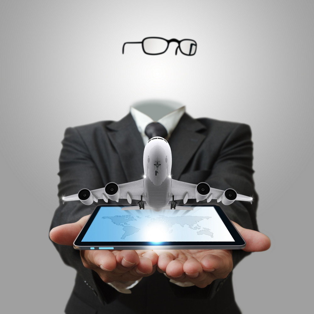 Invisible Business Man Shows Tablet Computer With Aircraft As Concept