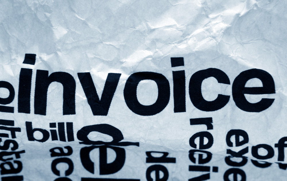 Invoice Text On Crinkled Paper
