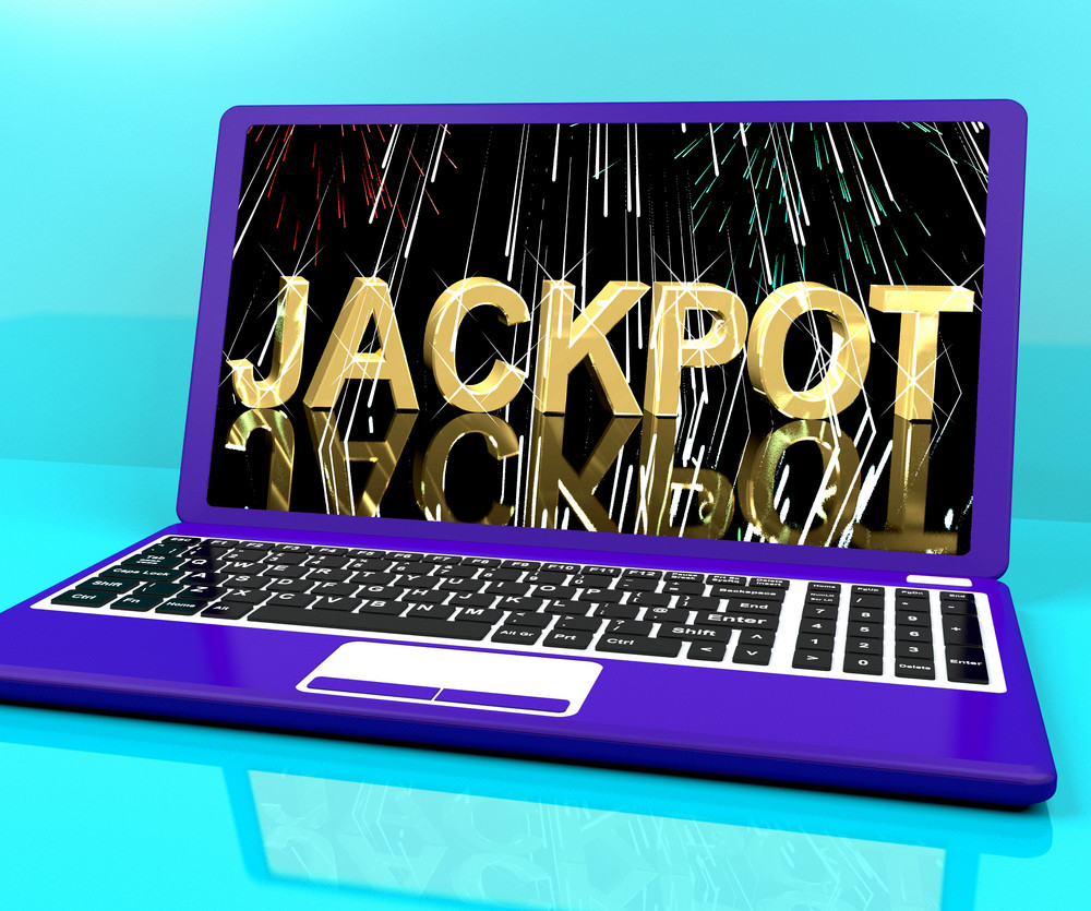 Jackpot Word With Fireworks On Laptop Showing Winning