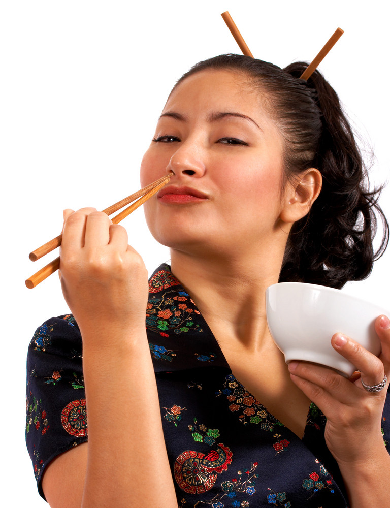 Japanese Girl Eating With Chop Sticks