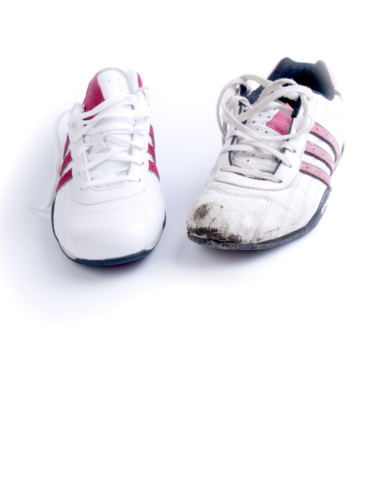 Jogging Shoes, New And Used On White Background