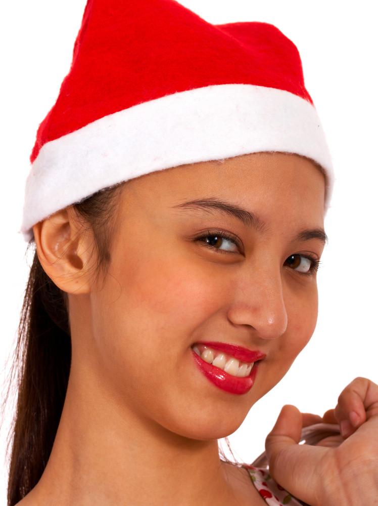 Joyful Girl Wearing A Christmas Hat