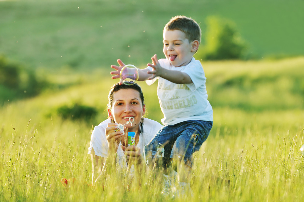 Mother and child play with bubbles