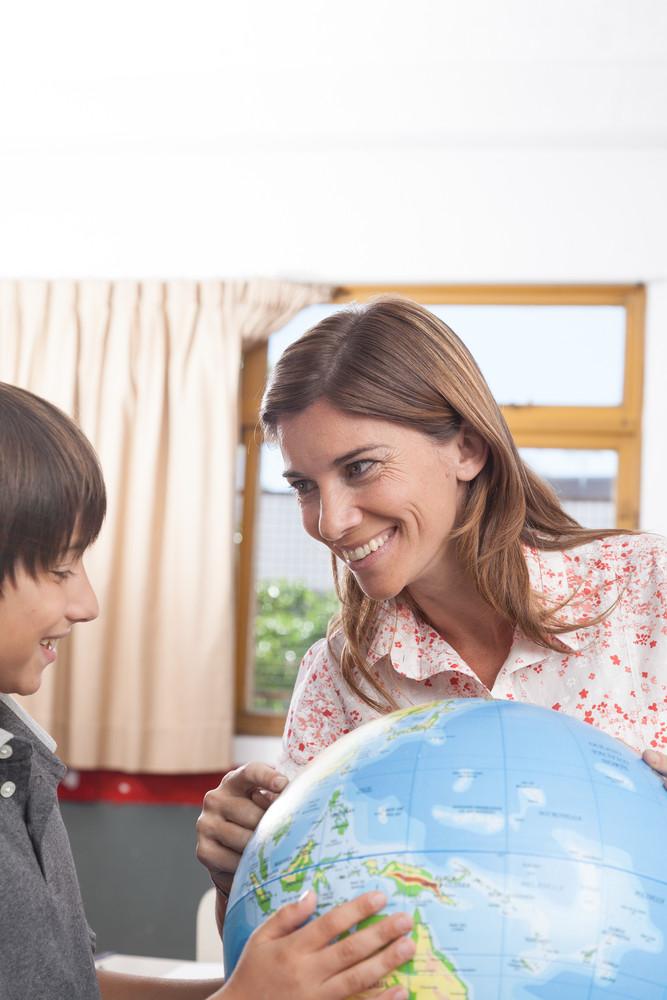 Kids looking the Globe