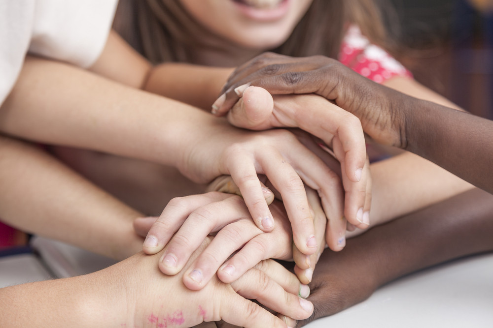 Kids puting his Hands together