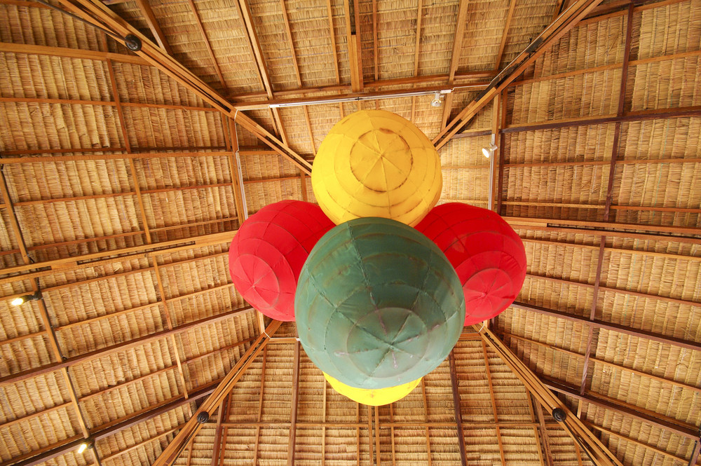 Lantern light on bamboo ceiling