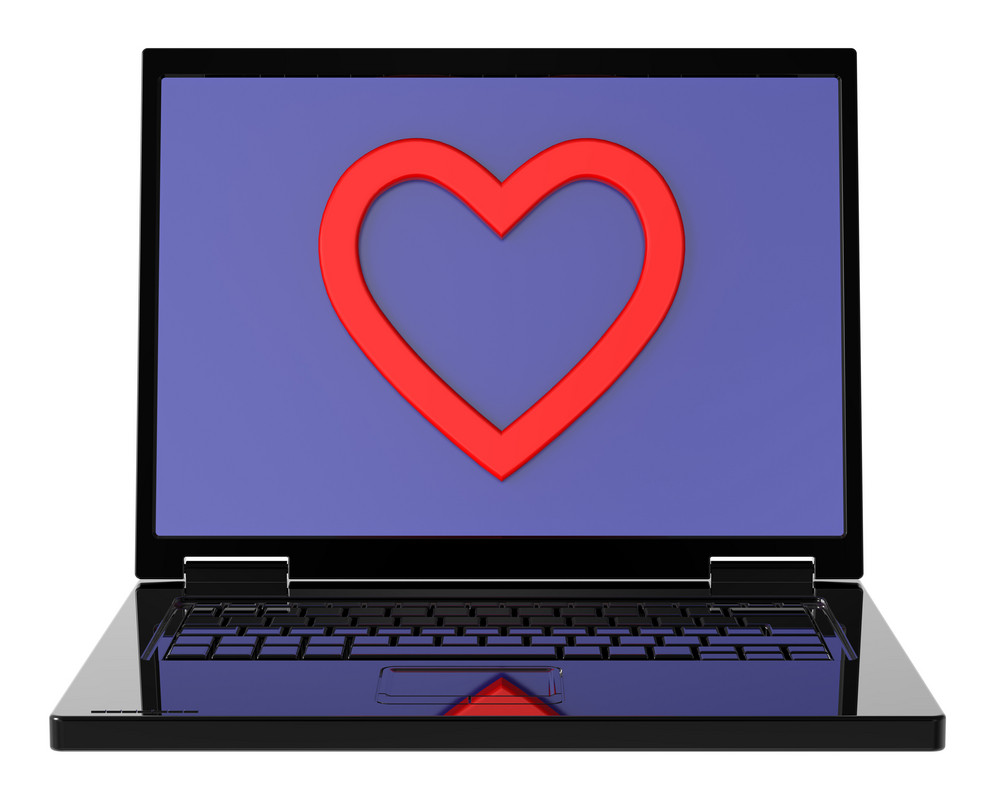 Laptop With Heart On The Screen Isolated Over White Background.
