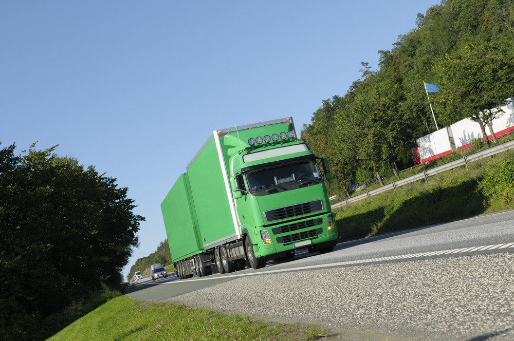 large green truck on highway