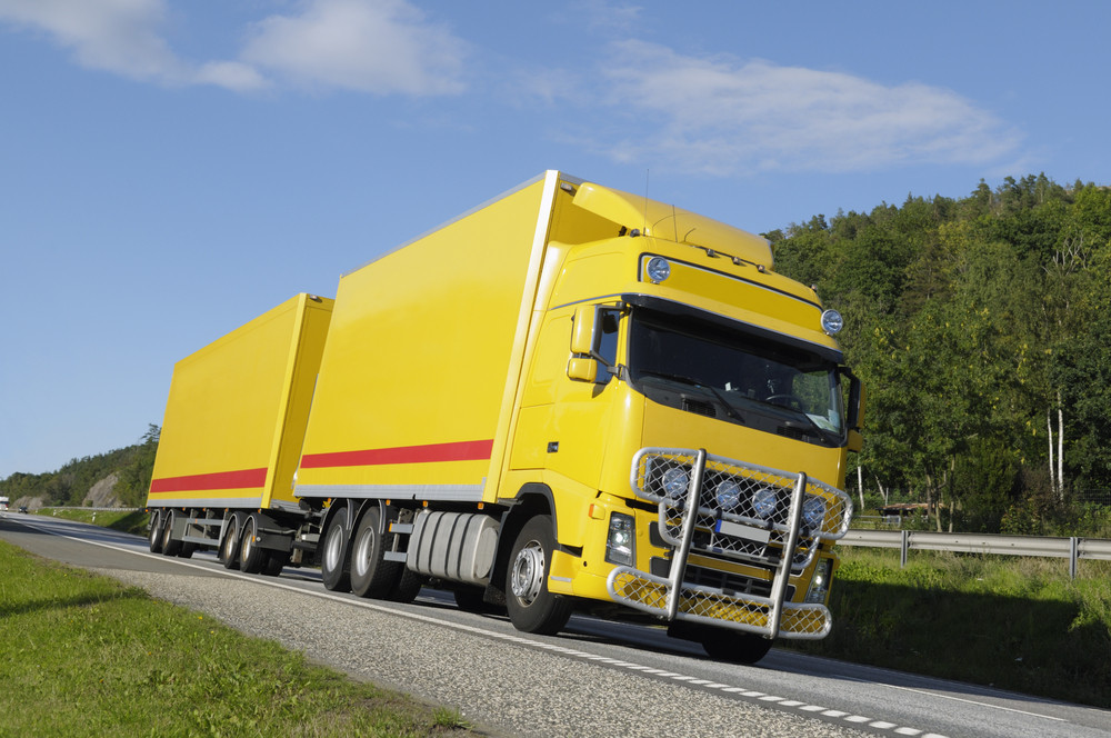 large yellow truck on highway