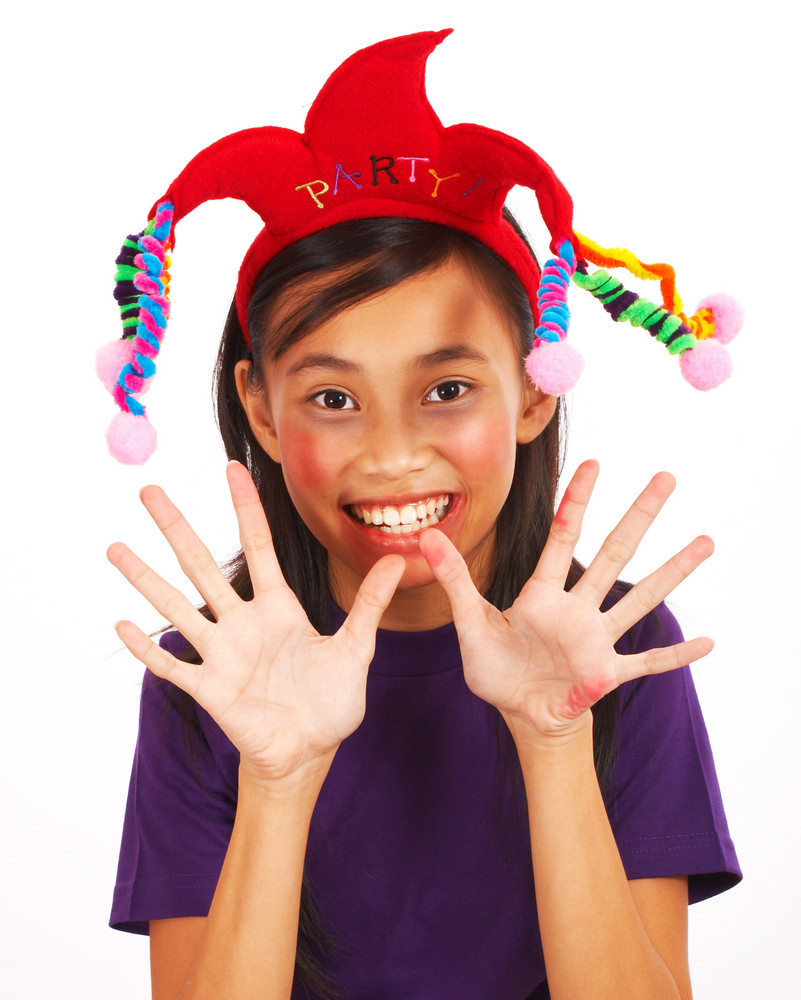 Laughing Girl With A Joker Hat