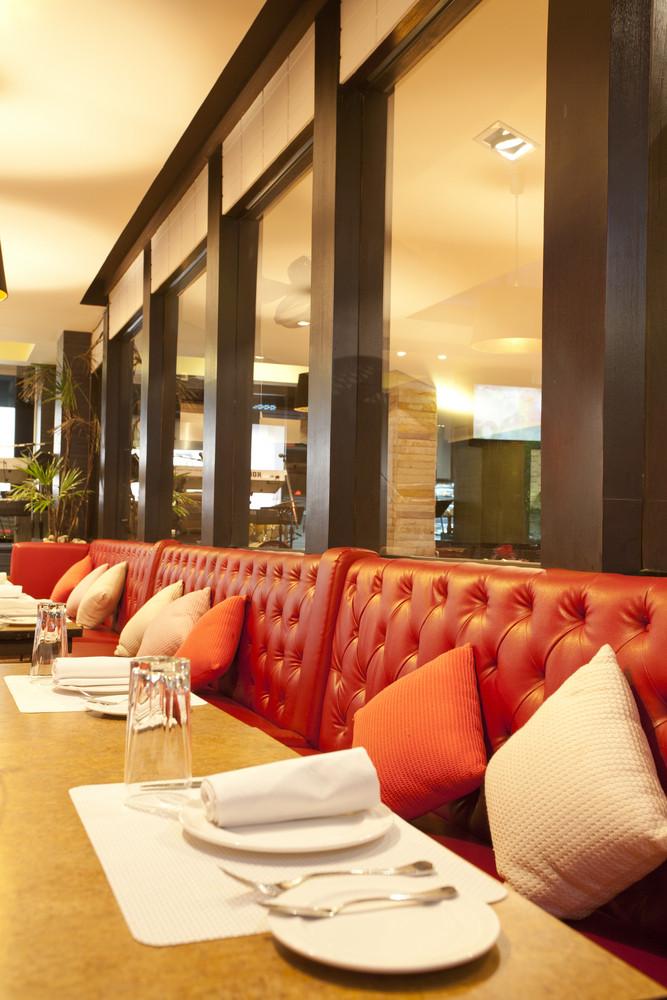 Leather chairs near mirror in steak restaurant