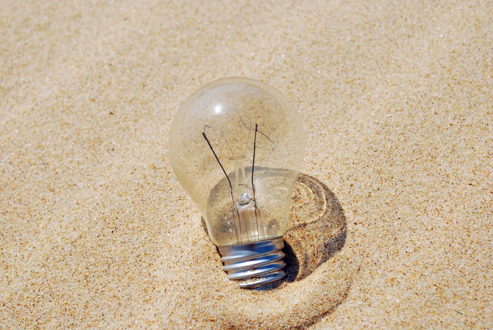 Lightbulb On Sand (global Warming)