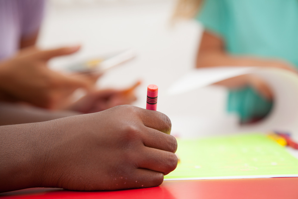 Little african boy drawing