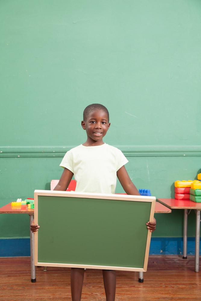 Little boy holding a balckboard