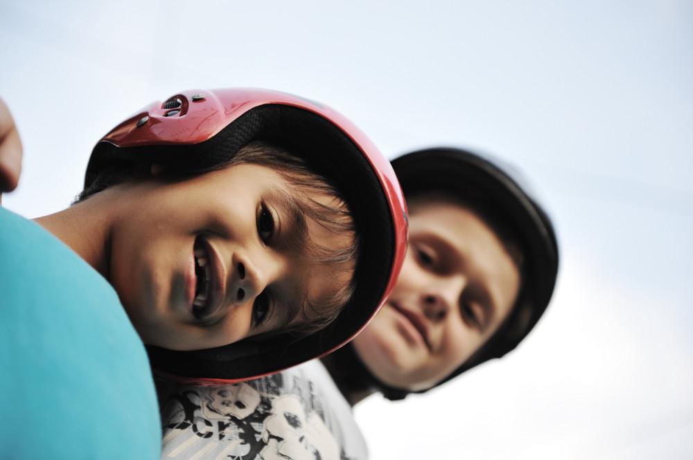 Little boys  with biking safety helmet portrait