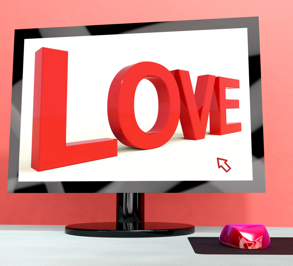 Love Word On Computer Screen Showing Online Dating