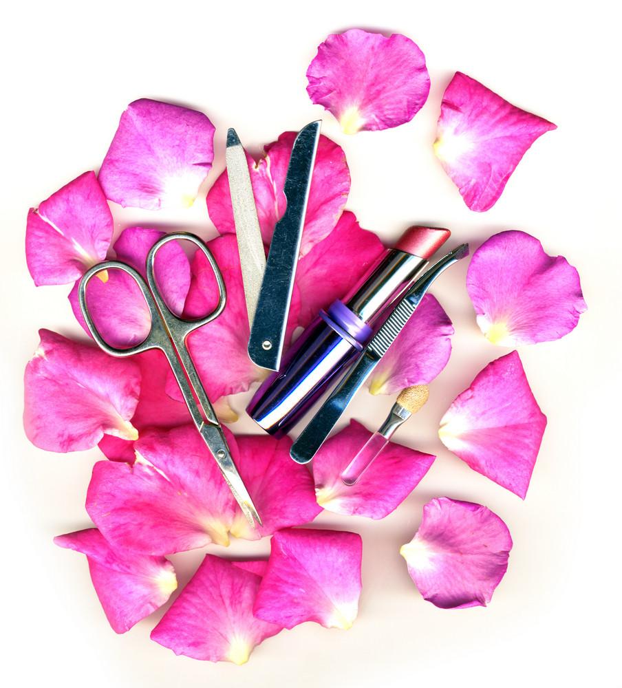 Makeup Brush And Cosmetics With Pose Petals