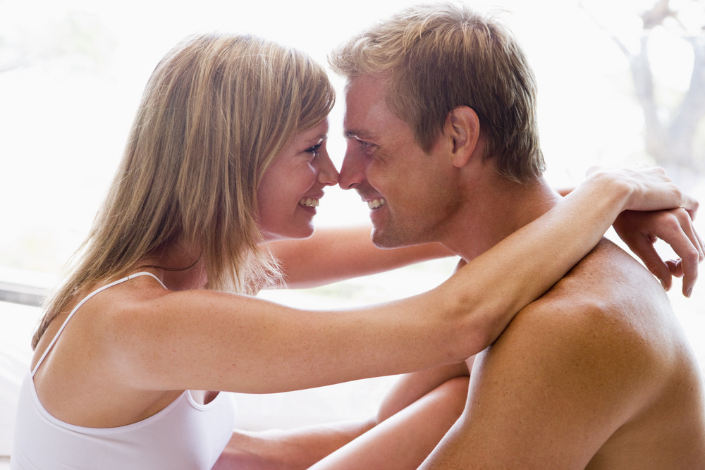 man and women cuddling indoors