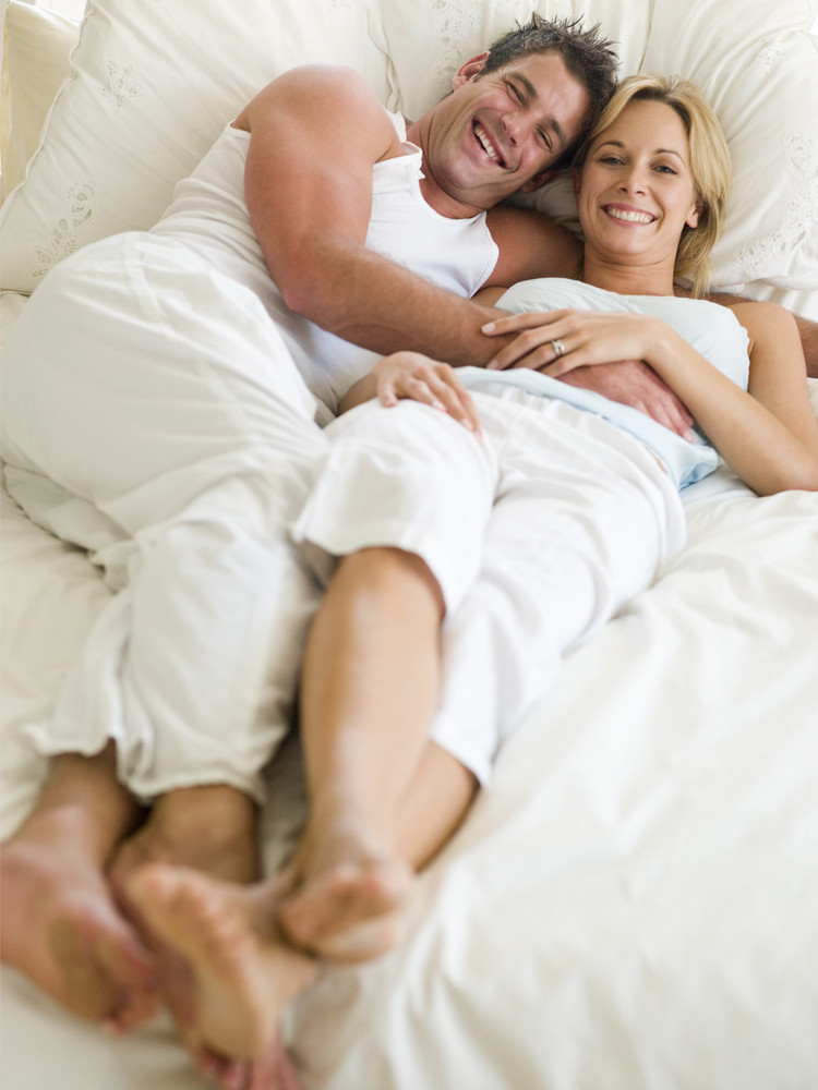 Man And Women Laying On A Bed Royalty Free Stock Image Storyblocks