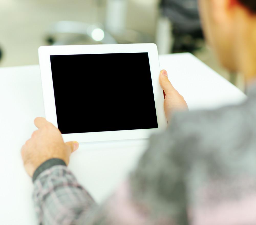 Man holding digital tablet computer