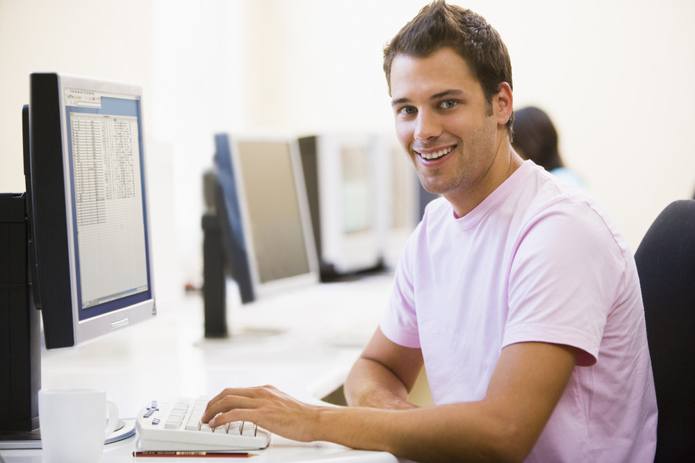 Man in computer room smiling