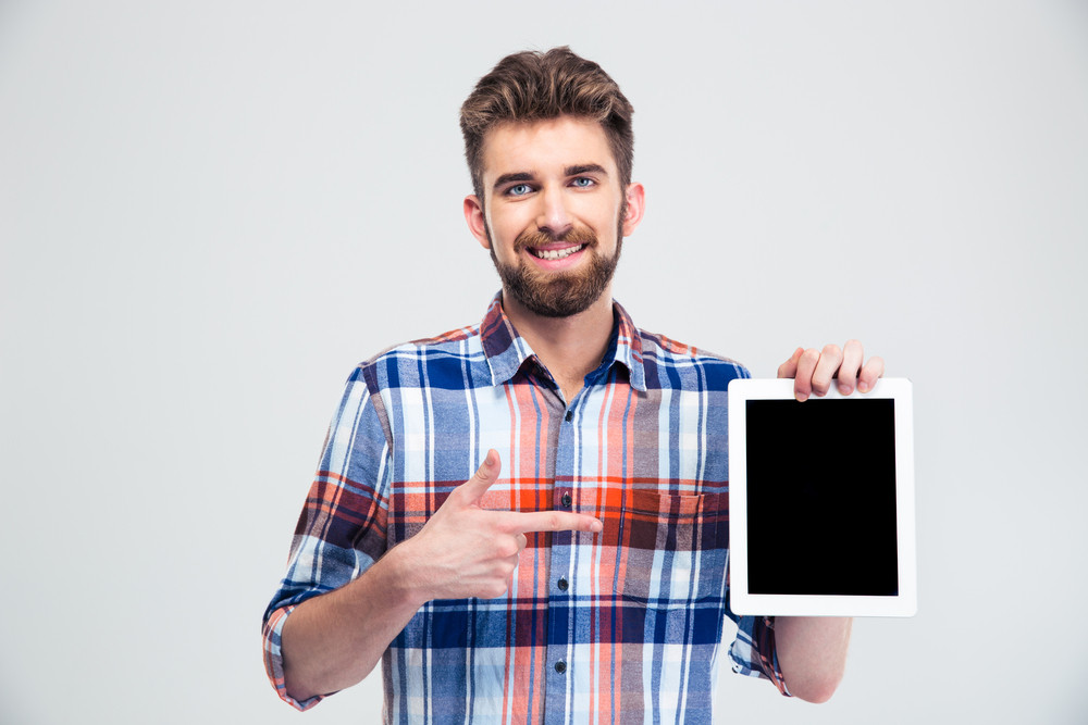Man pointing finger on blank tablet computer screen is