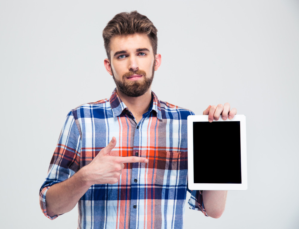 Man pointing finger on blank tablet computer screen