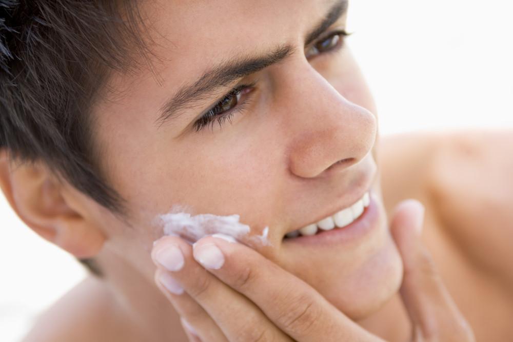 Man putting on shaving cream smiling