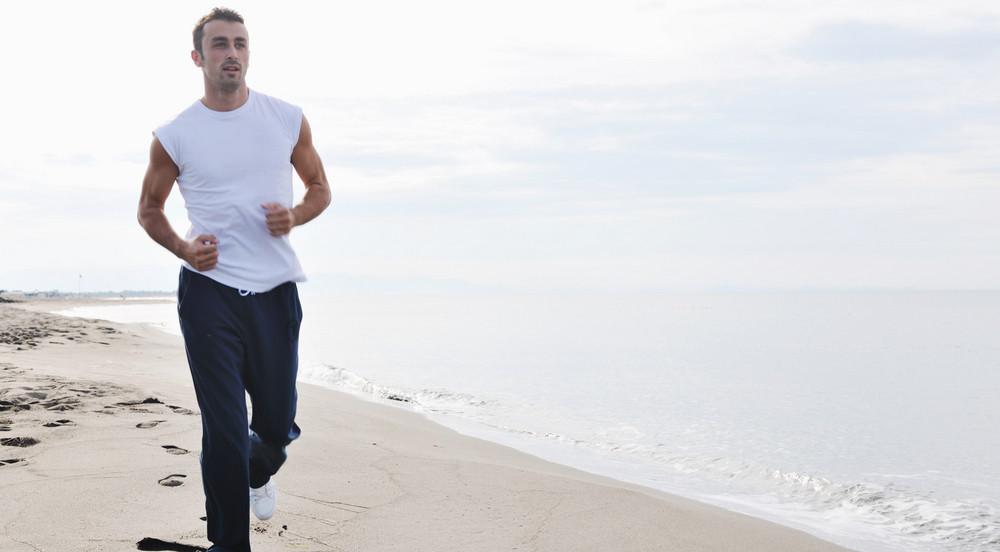 Man Running On Beach