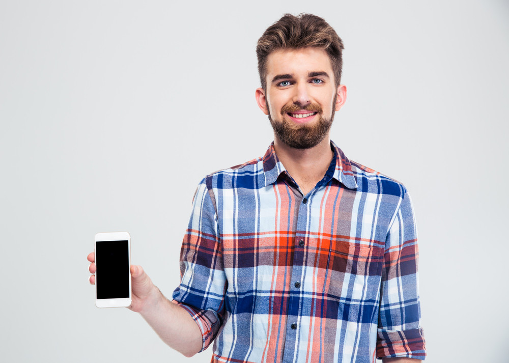 Man showing blank smartphone screen