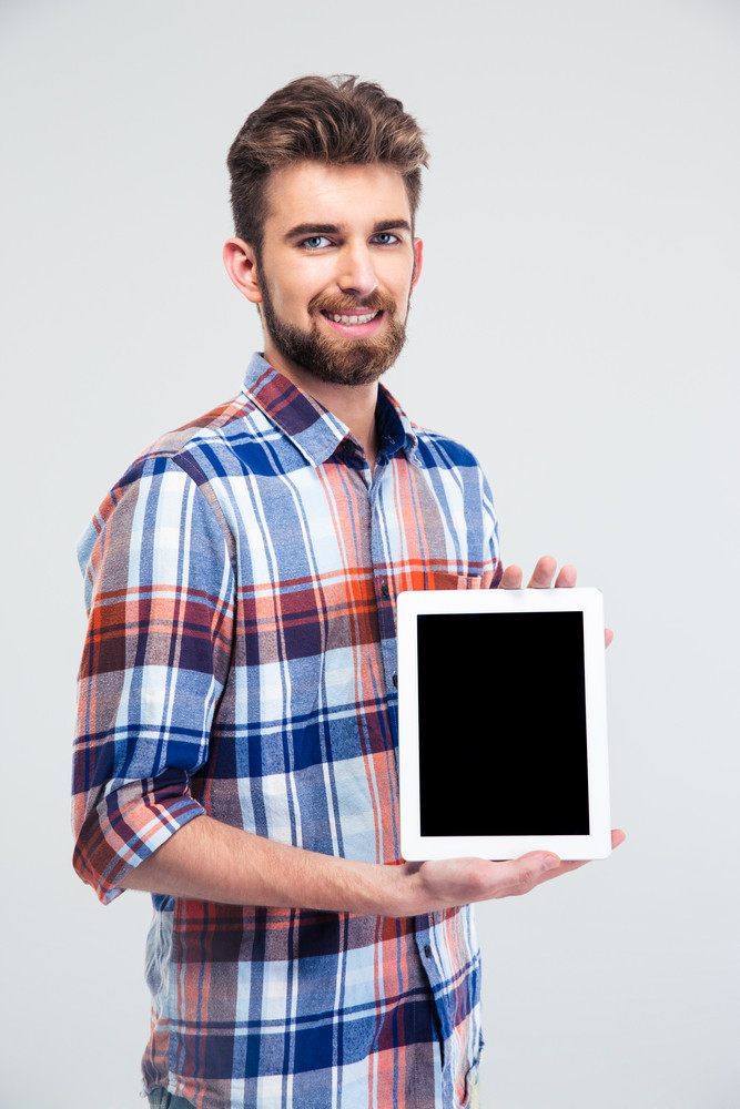 Man showing blank tablet computer screen