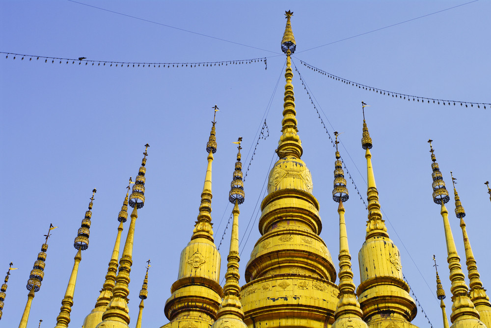 many tops of gold pagoda with blue sky