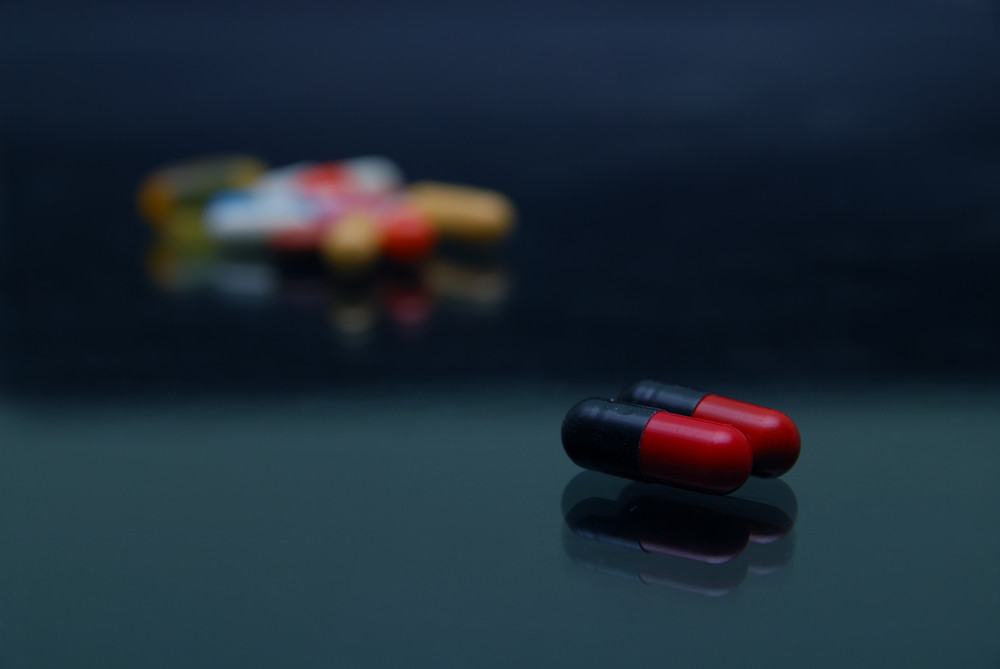 Pills on glossy surface