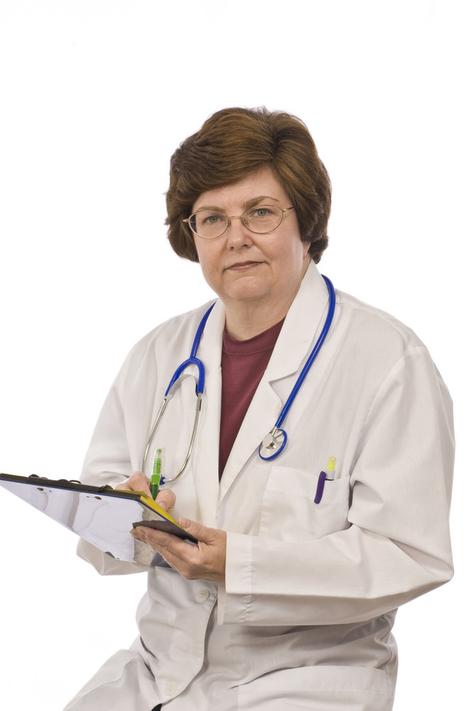 Middle-aged Doctor With Clipboard