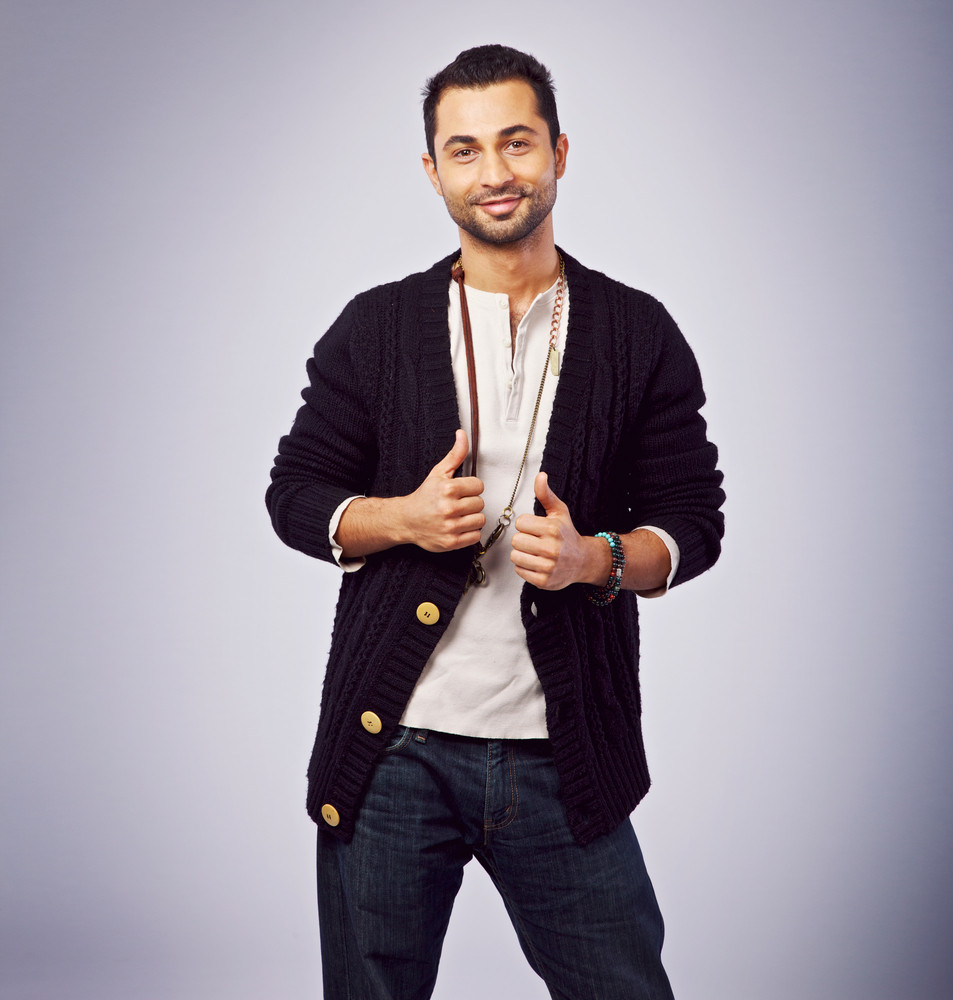 Middle eastern guy in a studio posing for the camera