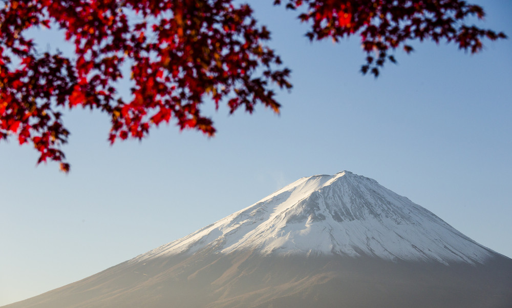 Mount Fuji with red autumn leaf. Japan