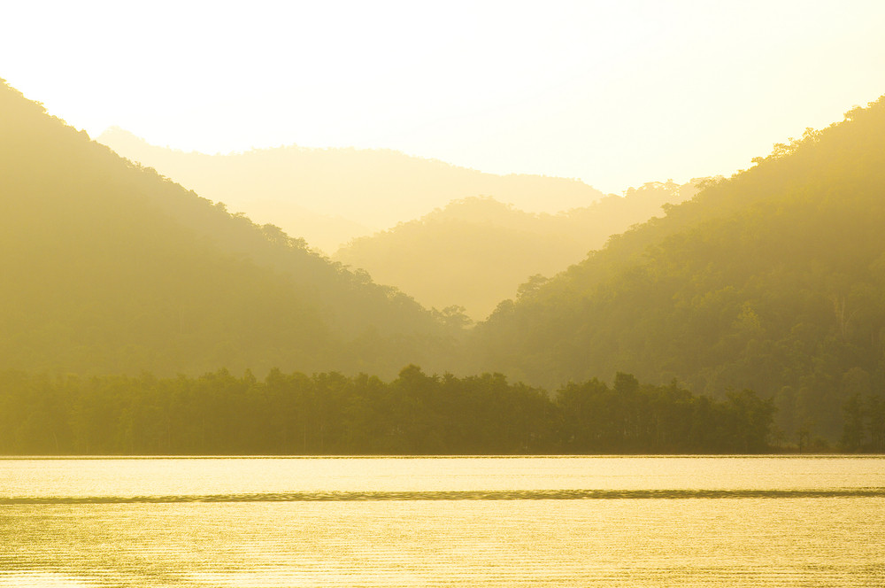 Mountain Lake with sunset sky and light