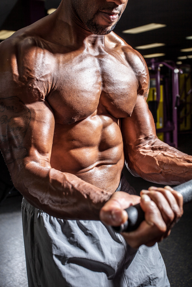 Muscular body builder working out at the gym. Royalty-Free Stock ...