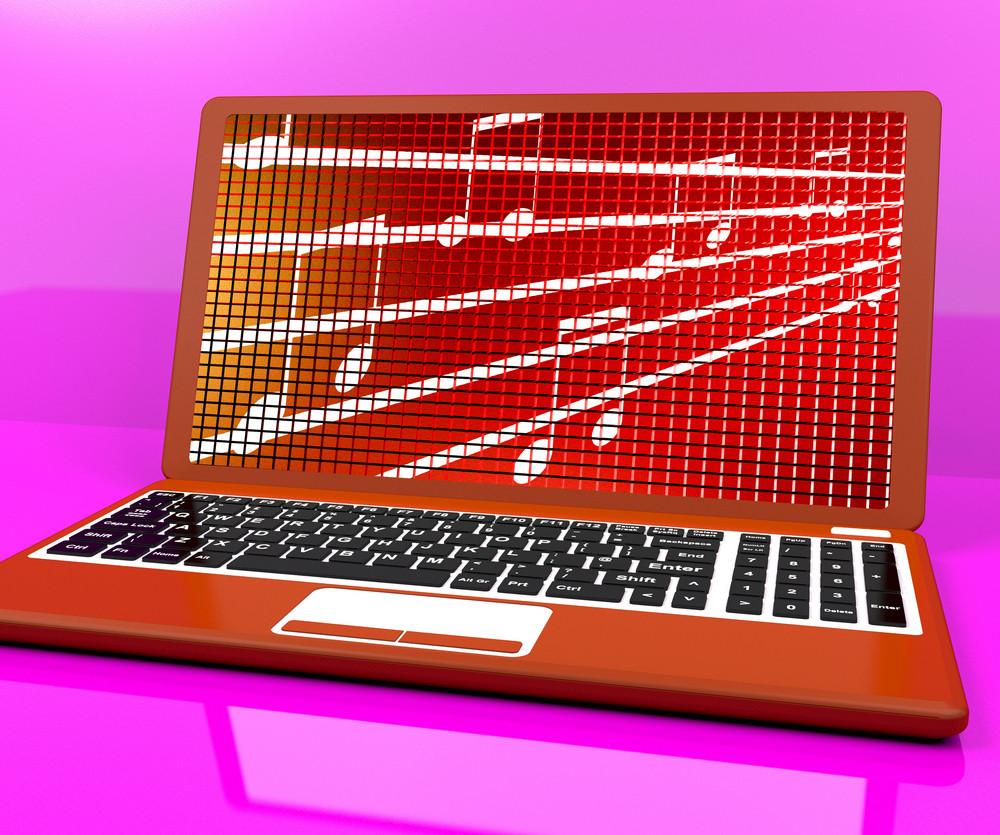 Music Symbols On Laptop Shows Online Radio